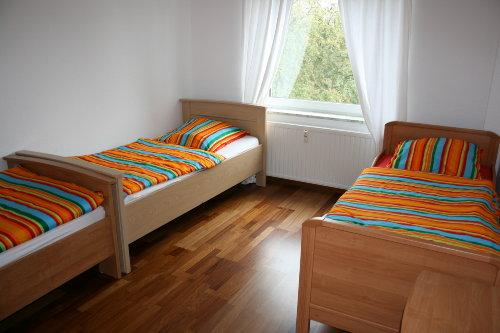 Schlafzimmer 1 mit drei Betten