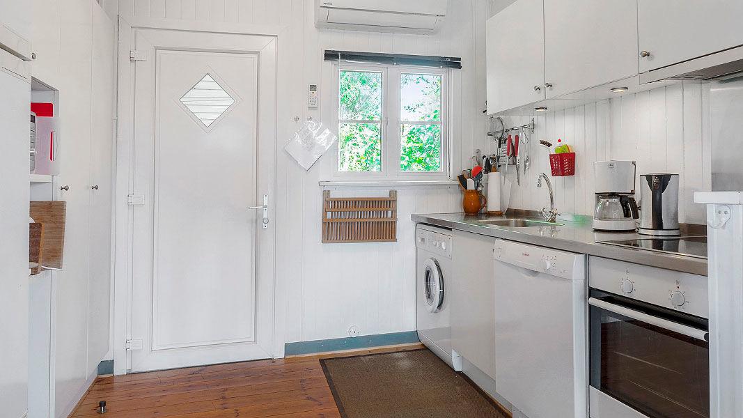Essbereich mit Ofen im Jens Hus