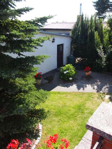 Der Eingang vom Ferienhaus im Garten