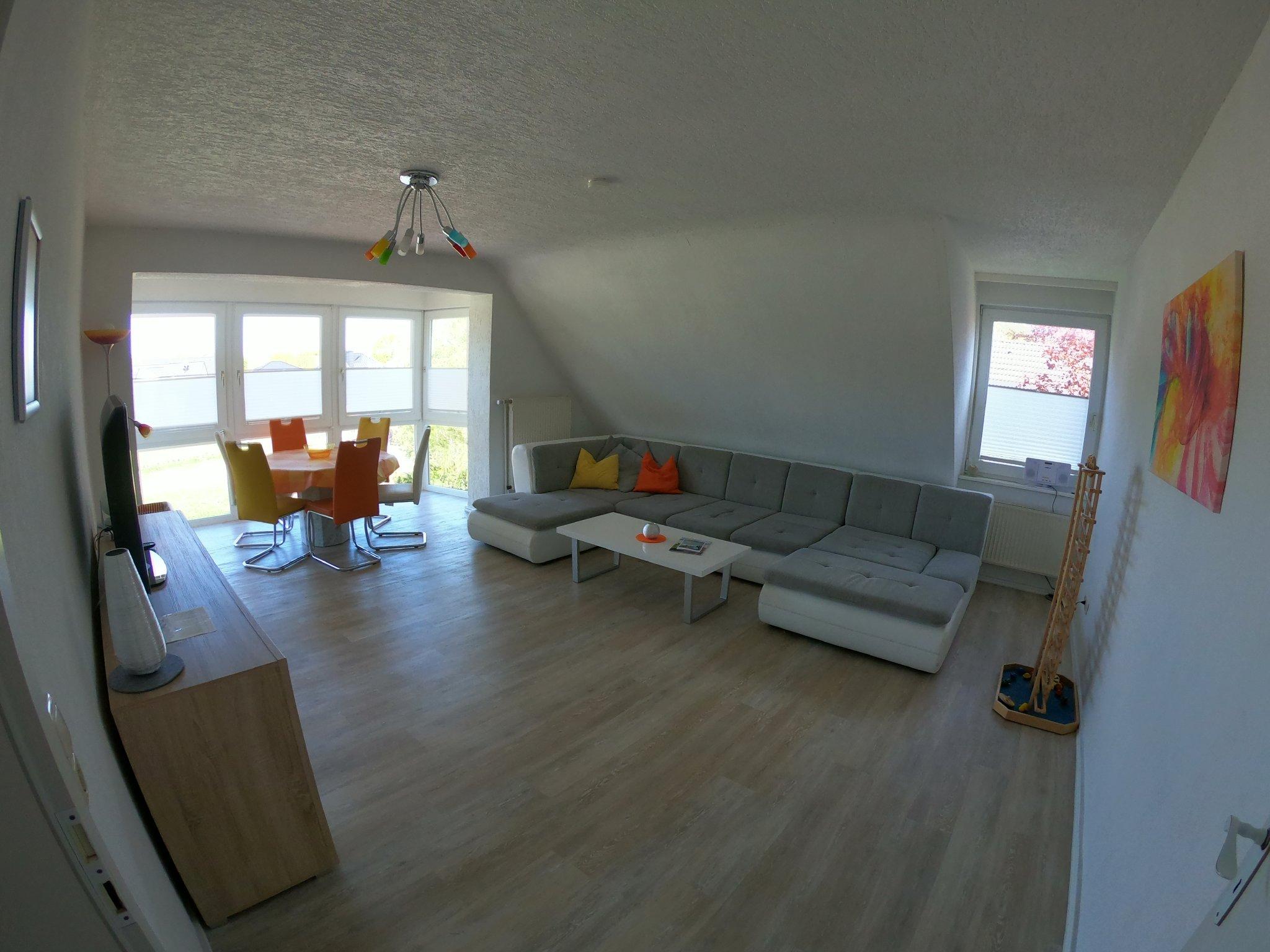 Wohnzimmer, Sonnenerker, Esstisch, TV