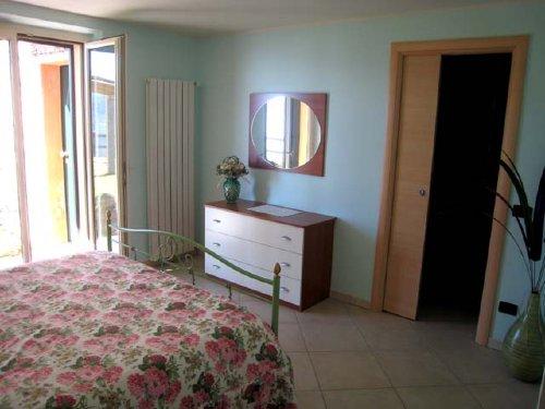 Schlafzimmer mit Umkleidekabine