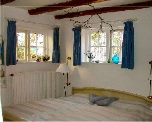 Schlafzimmer mit Blick zum See