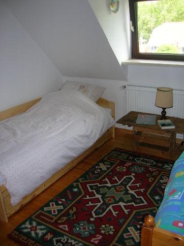 linke Seite vom Doppelbett Zimmer