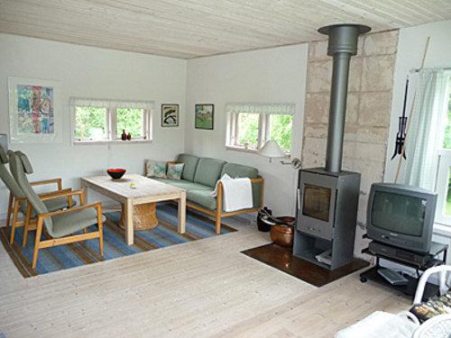 Wohnbereich mit Ofen im Mortens Hus