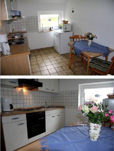 Küche mit Geschirrspüler und Mikro