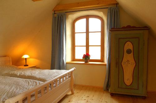 1 Schlafzimmer von dreien im Dachgeschoß