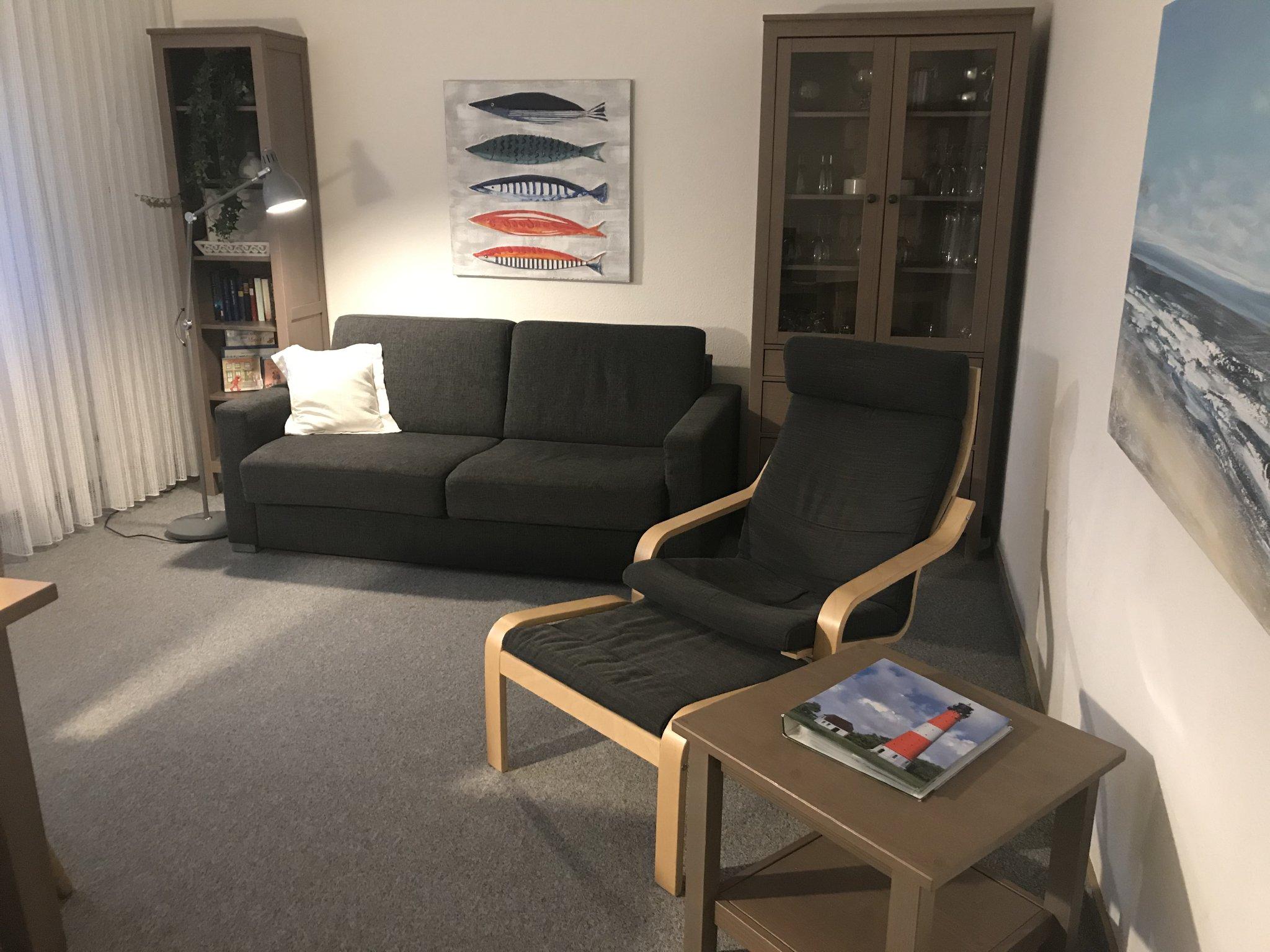 Wohnzimmer mit komfortablem Schlafsofa