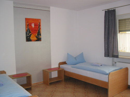 Schlafzimmer mit Zugang zur Terasse