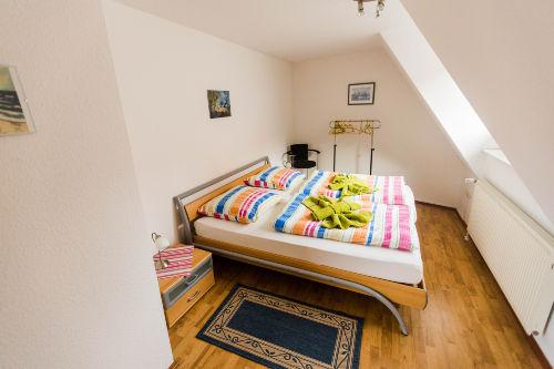 Dachgescho�-re.Doppelbettzimmer