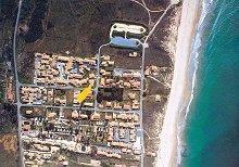Luftaufnahme mit Haus und Strand