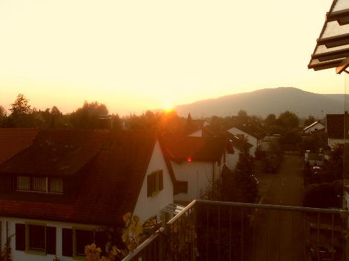 Blick vom Balkon zum Sonnenuntergang