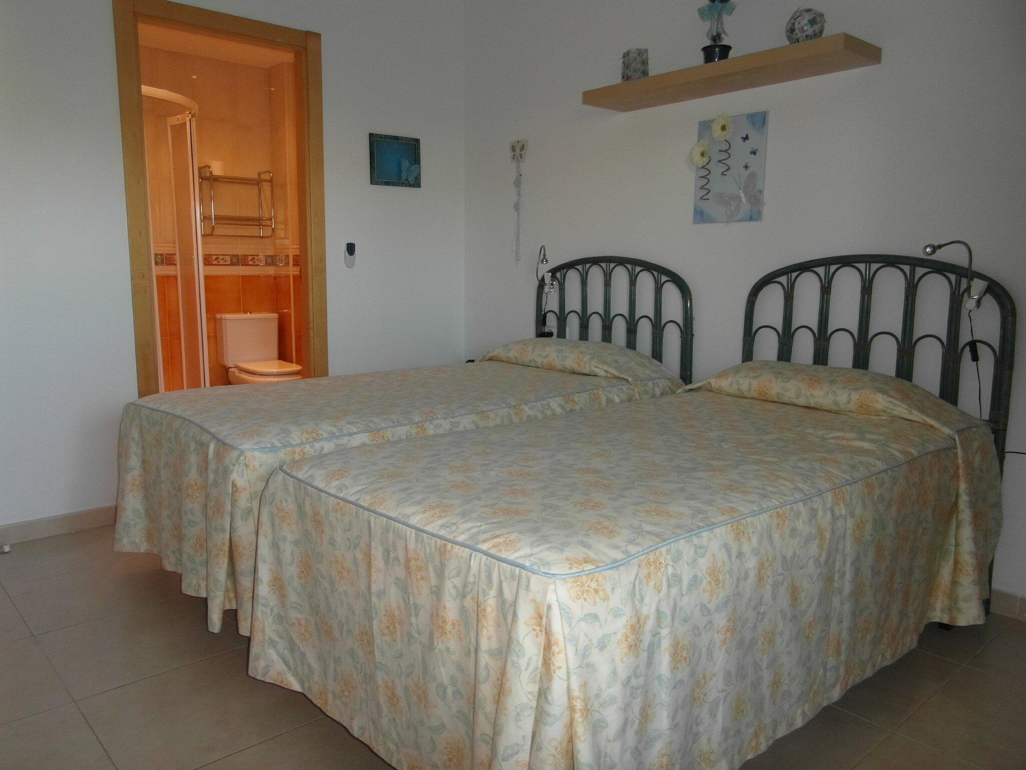 Schlafzimmer mit en-suite Badezimmer