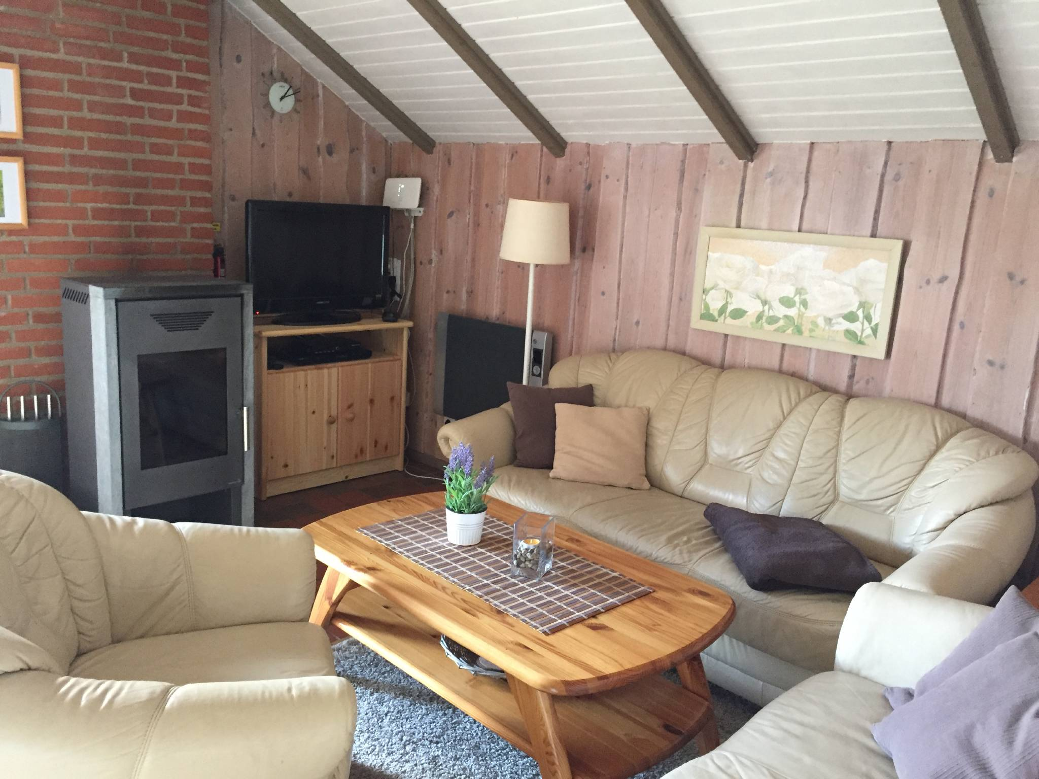 Wohnzimmer Sitzecke mit Kaminofen