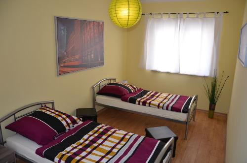 Schlafzimmer 1 - auch als Doppelbett