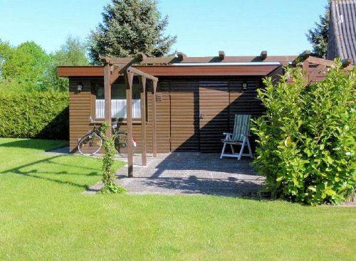 Holzblockhaus mit Waschmaschine/Trockner