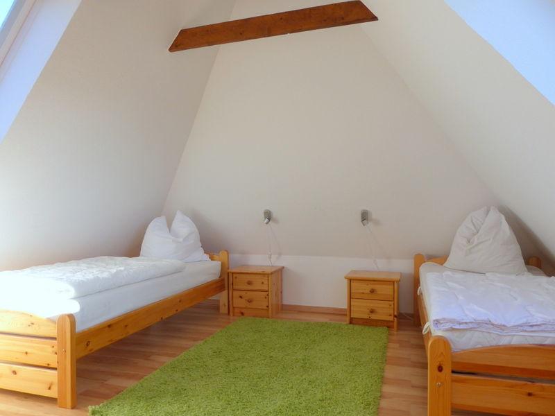 das dritte Schlafzimmer im Dachgeschoss