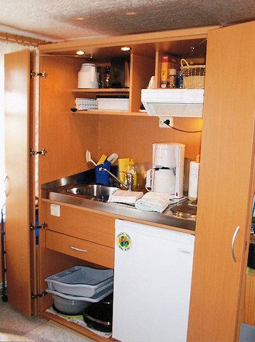 Schrankküche im Wohnzimmer