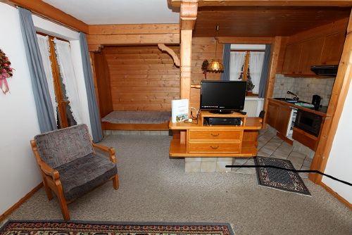 Wohnbereich mit eingebautem Alkovenbett