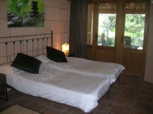 Schlafzimmer mit Terrasse und Toilette