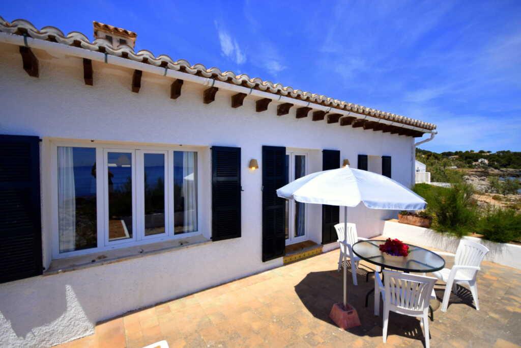 785910 Strandhaus Es Carregador