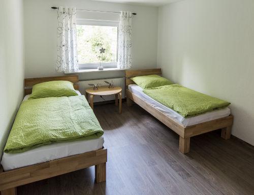 Schlafzimmer mit Einzelbetten Wohnung 2
