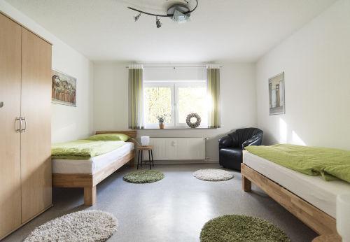 Schlafzimmer mit Einzelbetten Wohnung 3