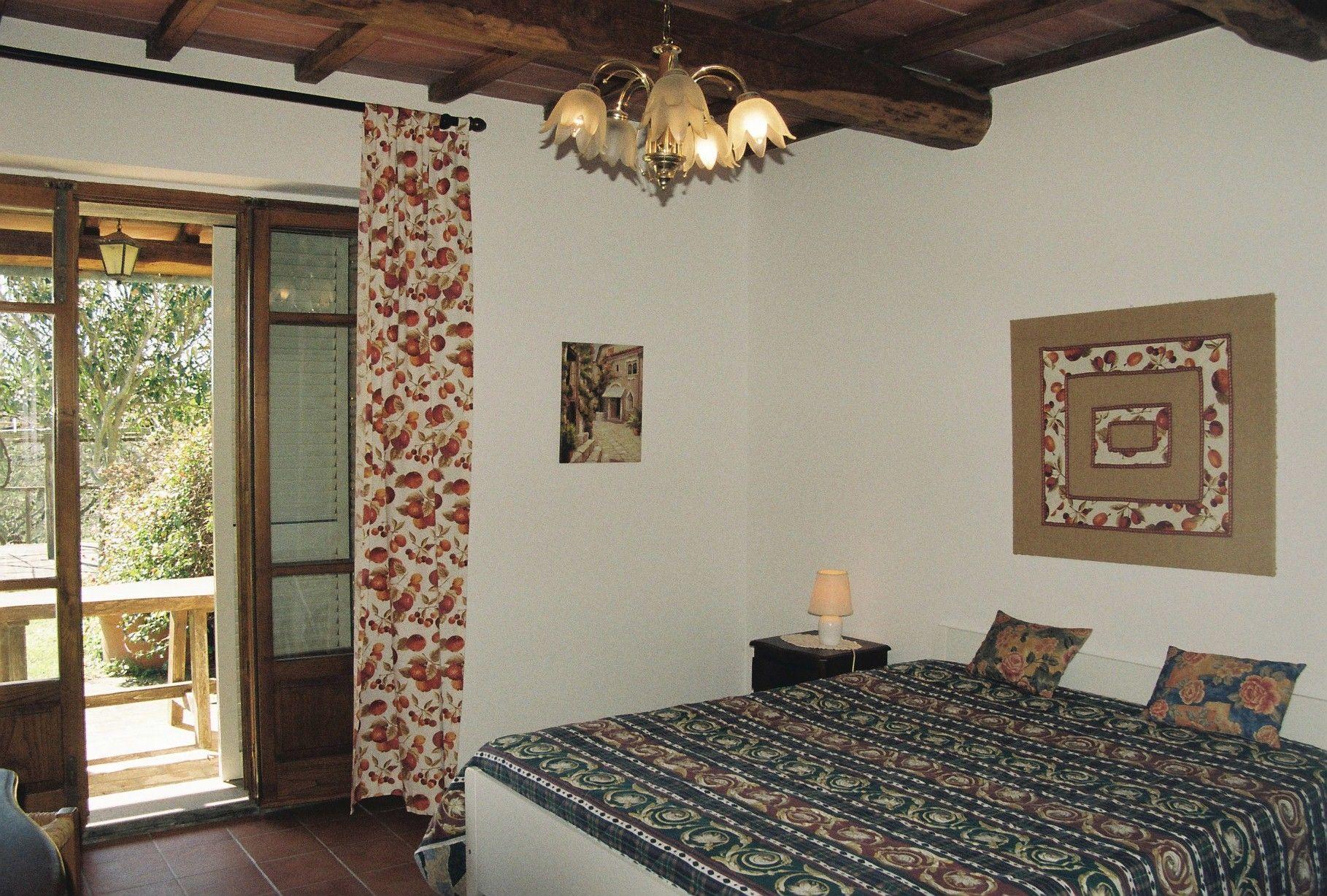 1. Schlafzimmer mit Terrassenausgang