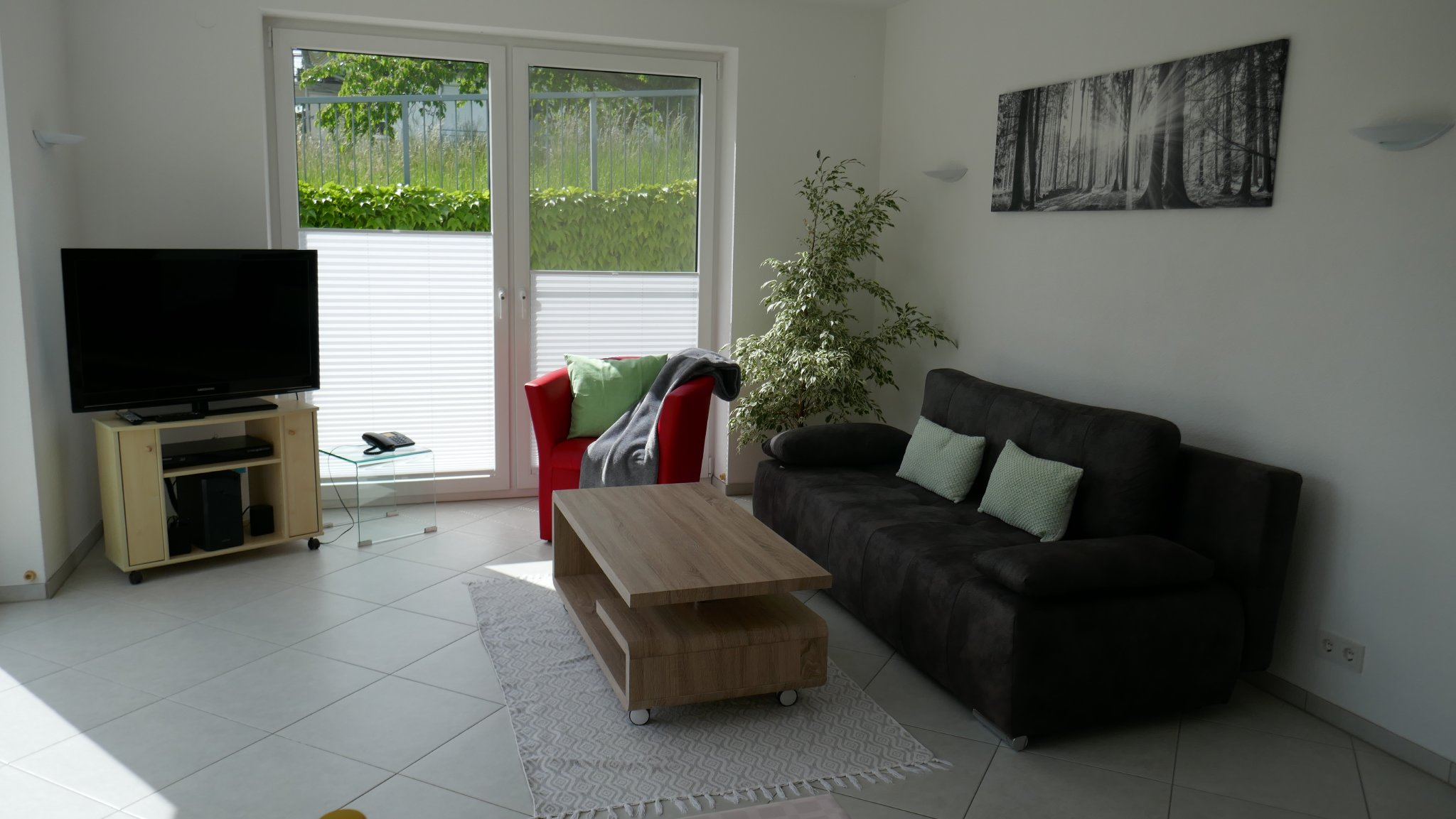 Wohnzimmer mit Südterrasse