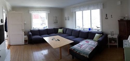 Living room with large brand new sofa