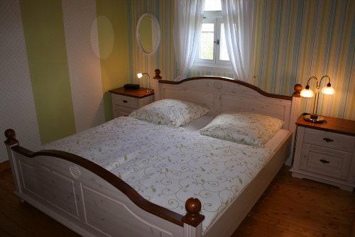 Das Schlafzimmer mit Holzdielenboden