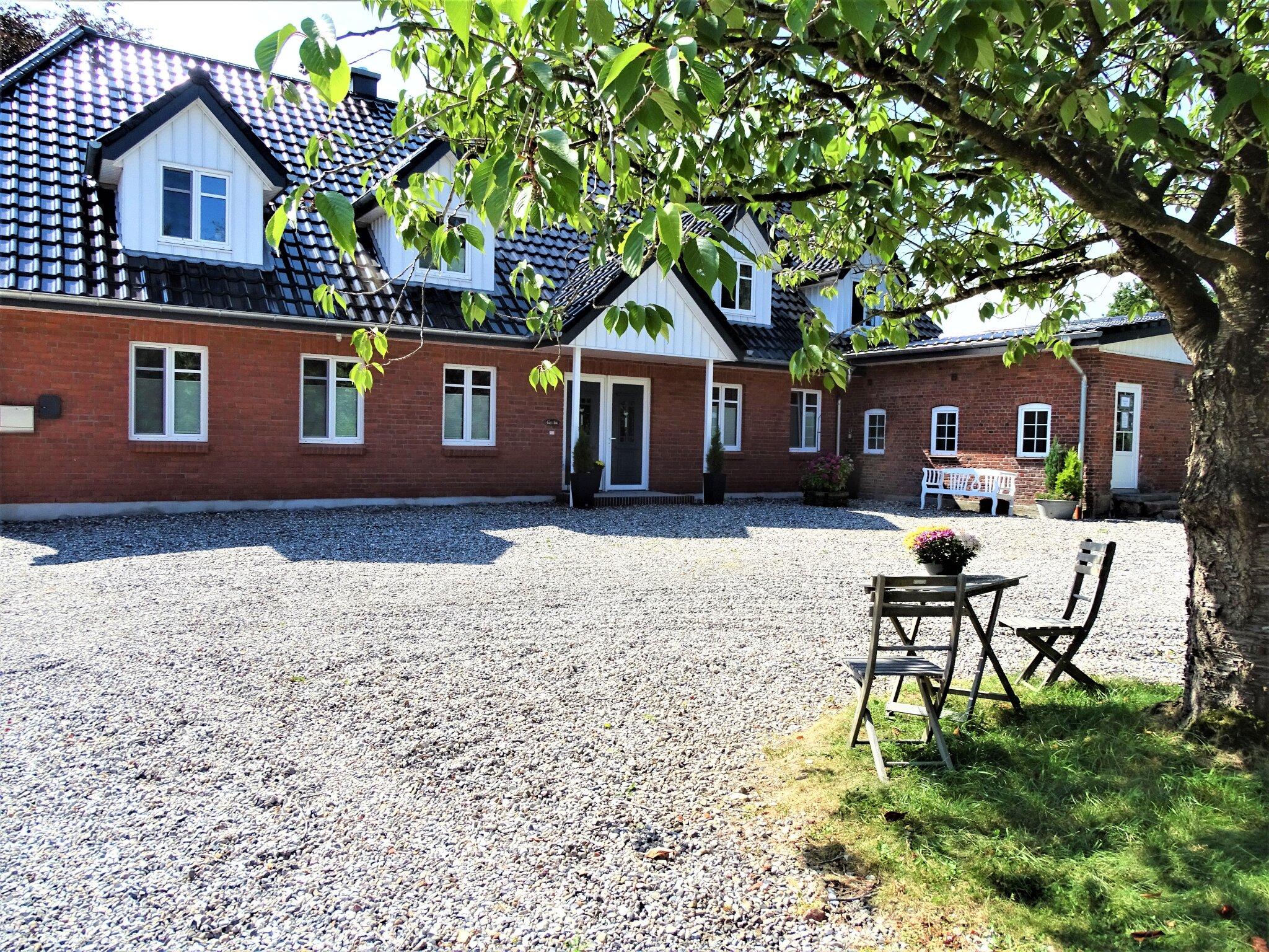 Ferienwohnung Buttjerhus mit Garten