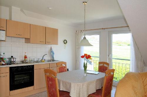 Küche mit Aussicht zum Golfplatz