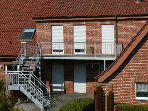 Überdachte Terrasse durch Balkon