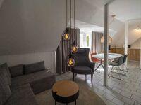 Strandhaus Grön, Ferienwohnung Gröde: So schön wohnt es sich zu viert unterm Dach in St. Peter-Ording - kleines Detailbild