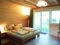 Schwedenhaus am Eichenberg, Gartenzimmer im Blockhaus in Eichenberg - kleines Detailbild