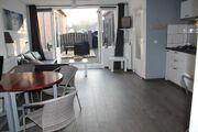 Wohnzimmer mit Französisch Türen zum Gar