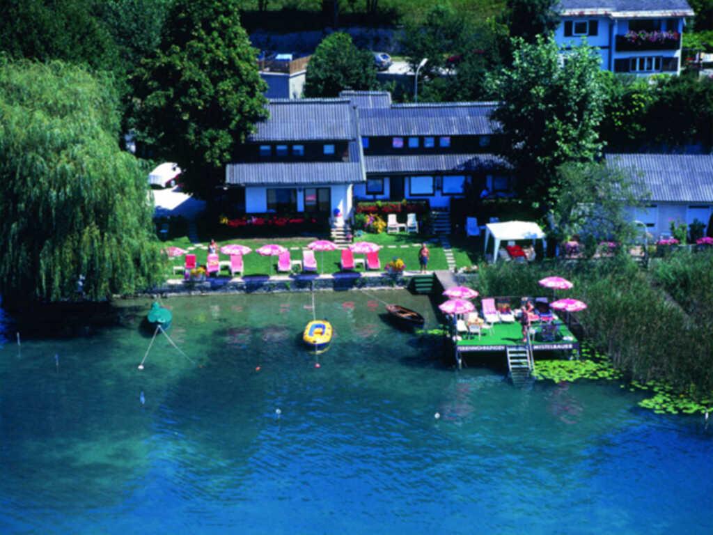 Ferienwohnungen Mistelbauer DIREKT am Faaker See, Ferienwohnung 1 (Gartenapartment mit Seebalkon)