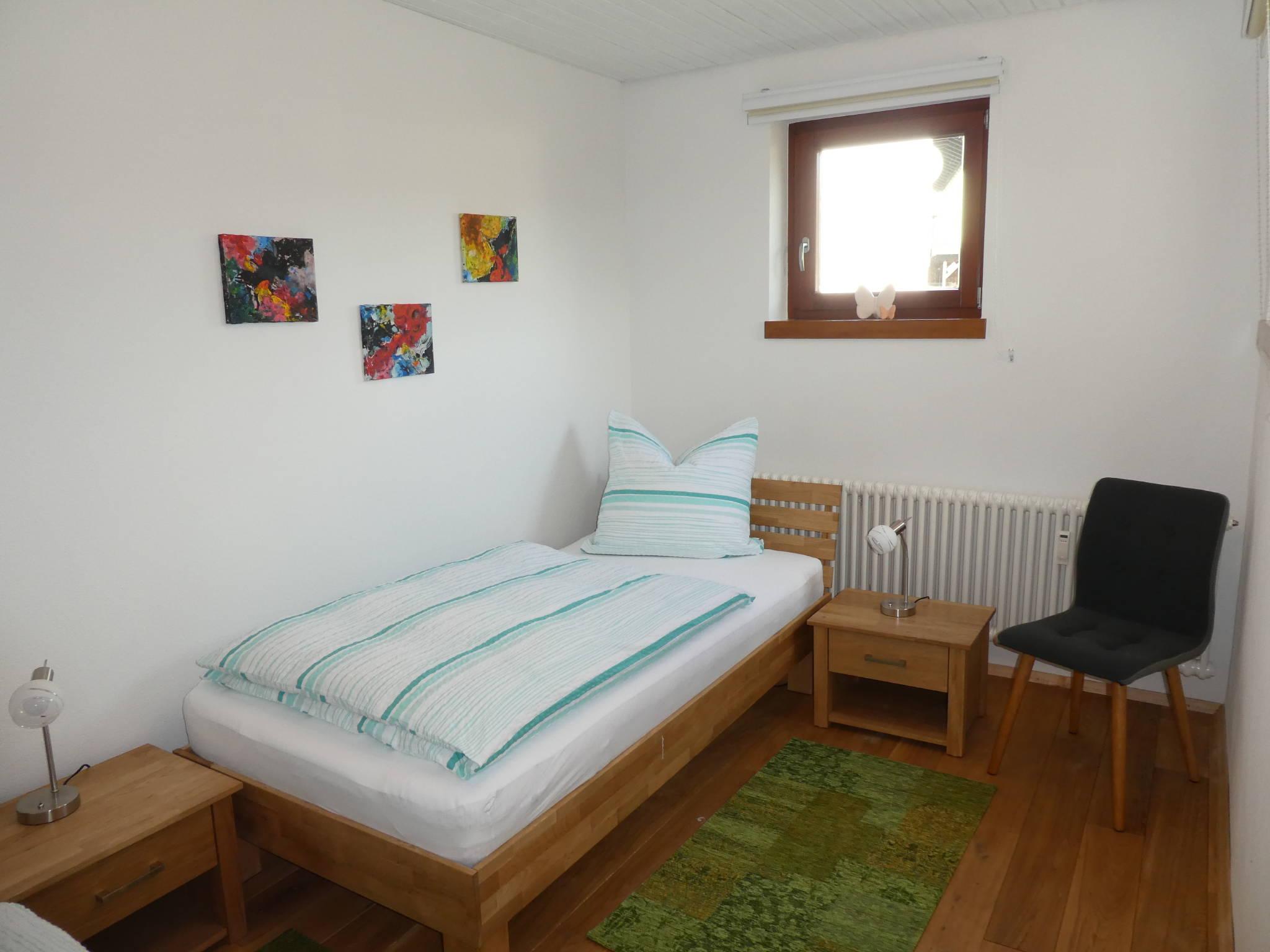 Schlafzimmer mit Treppenzugang
