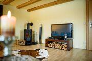Wohnzimmer: mit Schwedenofen, Flat-TV...