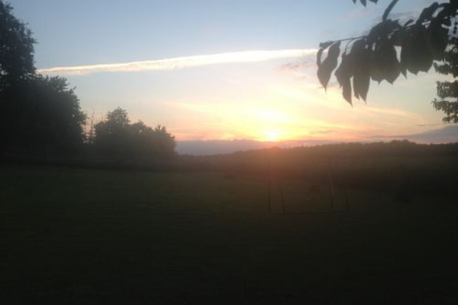 Blick vom Grundstück auf Sonnenuntergang