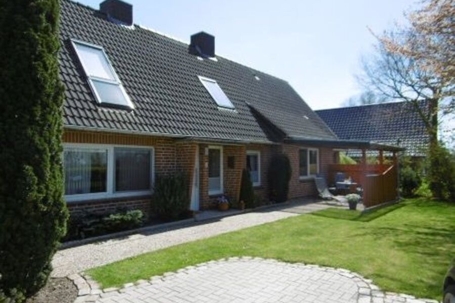 Ferienwohnung mit Sitzecke und Garten