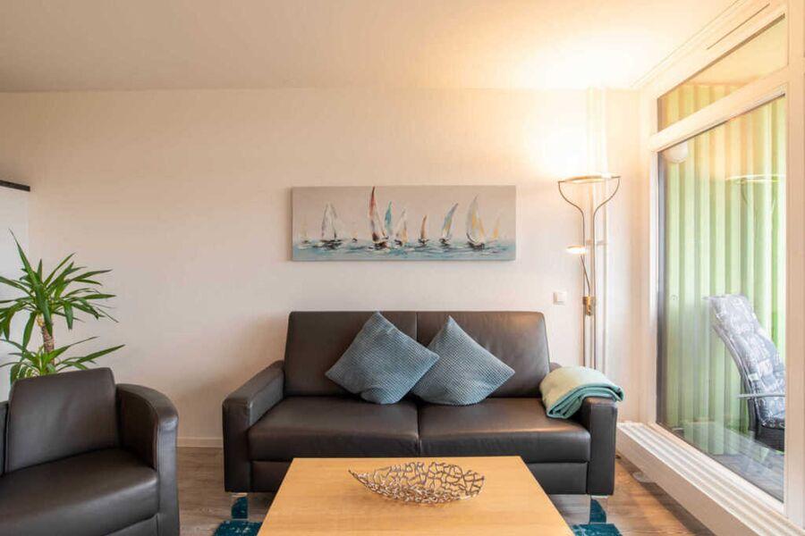 Ferienwohnung Achterdeck Wohnzimmer mit Couch