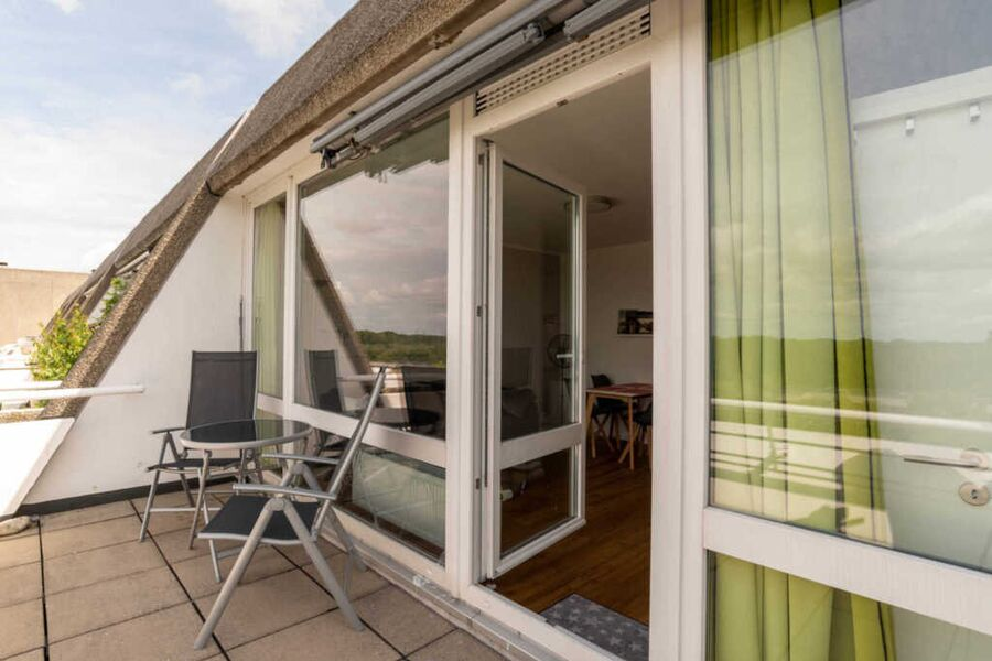 Ferienwohnung Utblick Balkon mit Gartenmöbeln