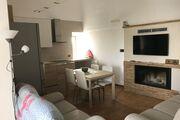 Wohnzimmer Küche mit Kamin