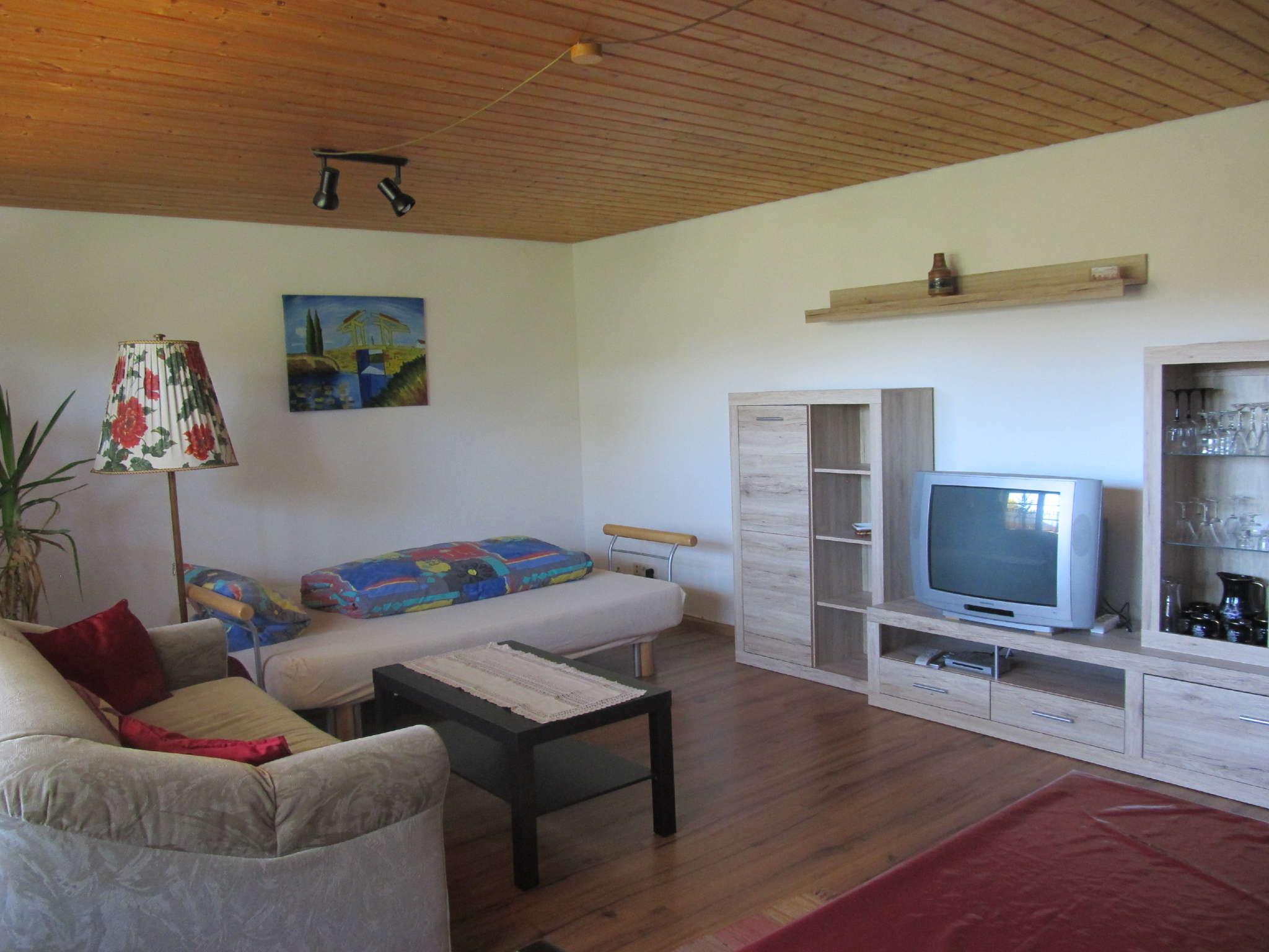 Wohnzimmer mit zusätzlicher Schlafcouch