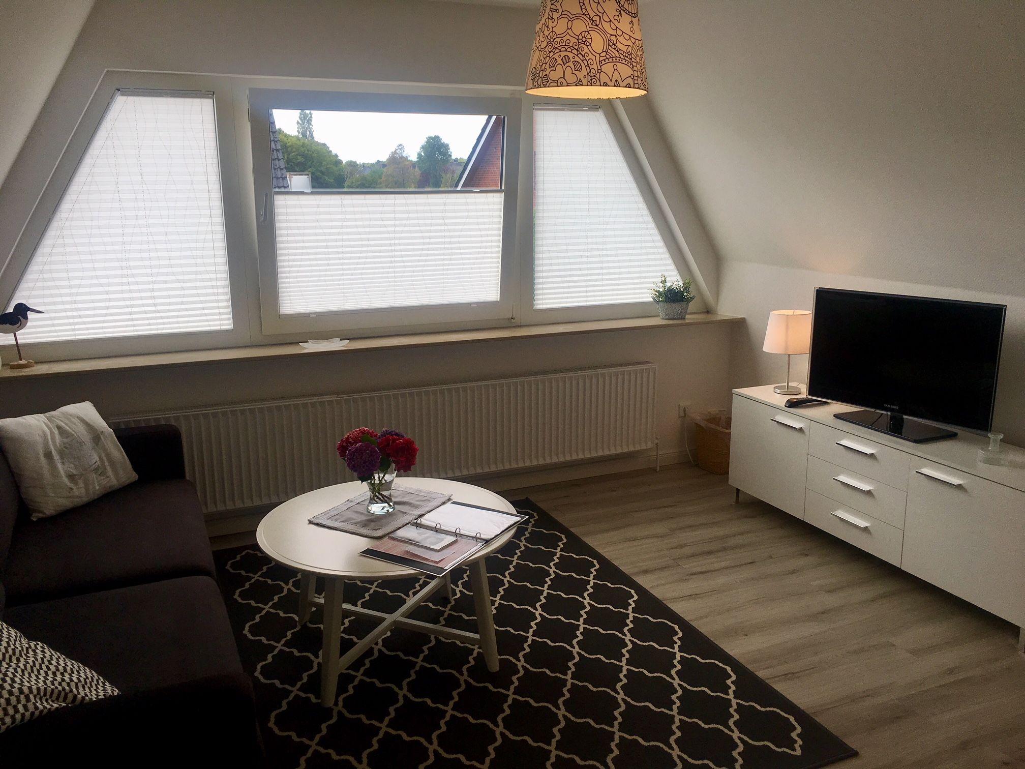 Ein sonniges, geräumiges Wohnzimmer