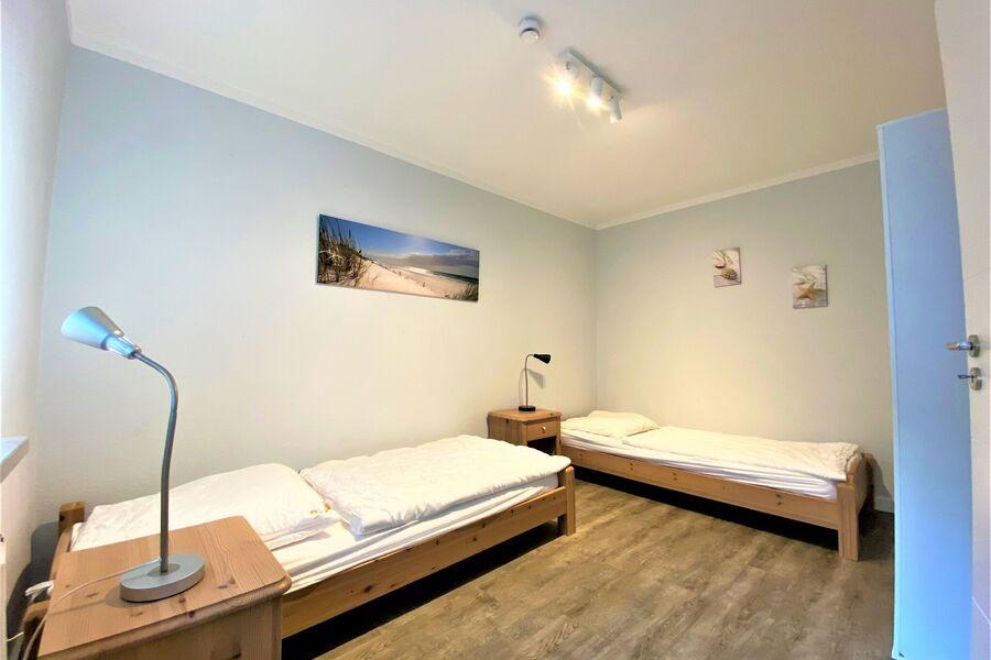 das Kinderschlafzimmer mit Einzelbetten