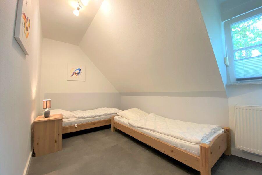 das Elternschlafzimmer mit Doppelbett