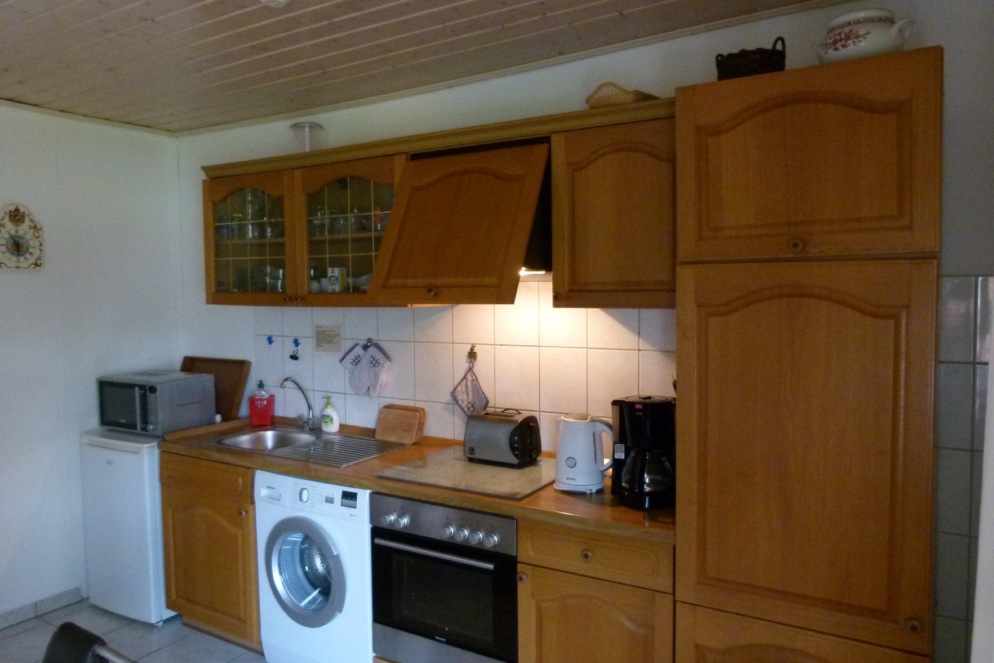 Wohnküche mit gemütlicher Fernsehecke