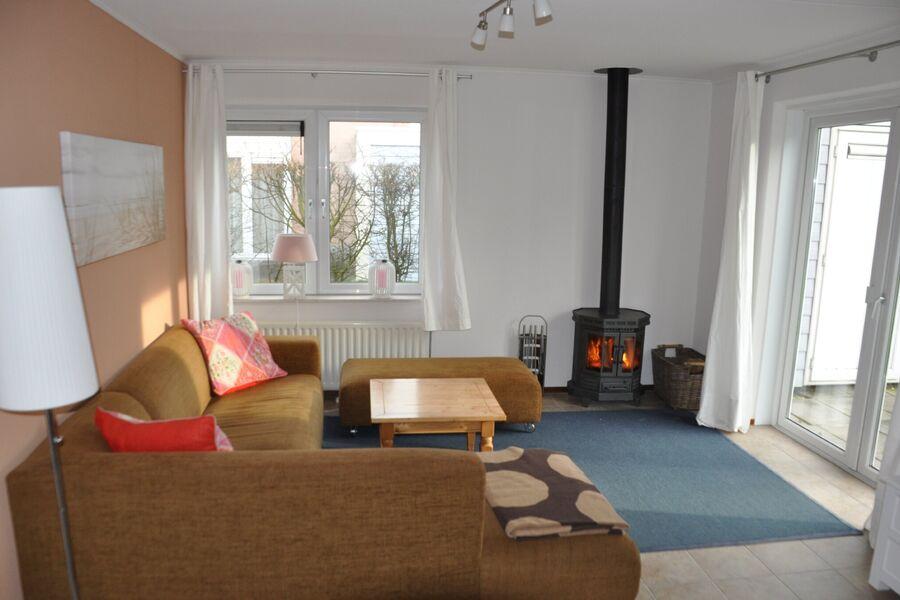 Wohnzimmer mit Kamin Duinpan 25